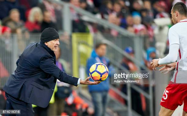 Trainer coach Juan Carlos Osorio of Mexico passes the ball to Jaroslaw Jach of Poland during the International Friendly match between Poland and...