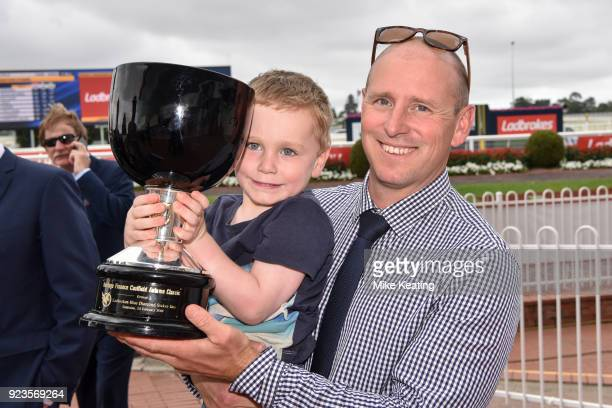 Trainer Daniel Williams with son Harrison with the trophy after Valiant Spirit wins the Heritage Finance Caulfield Autumn Classic at Caulfield...