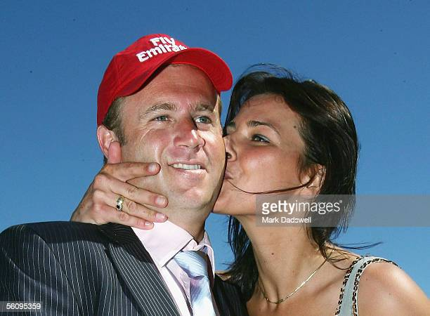 Trainer Danny O'Brien gets a celebratory kiss from girlfriend Nina Begagic after winning the Emirates Stakes with Valedictum during 2005 Emirates...