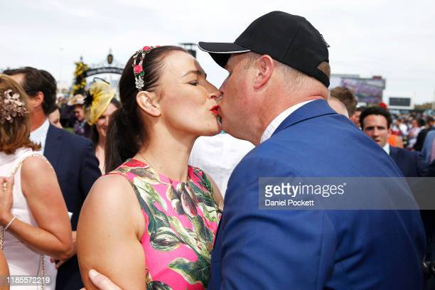 Trainer Danny O'Brien kisses his wife, Nina, after winning race 7 with Vow and Declare during 2019 Melbourne Cup Day at Flemington Racecourse on...