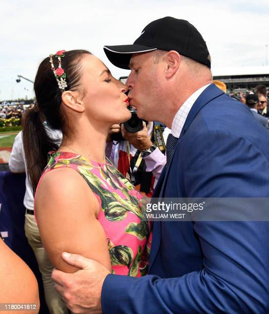 Trainer Danny O'Brien kisses his wife Nina after winning the Melbourne Cup horse race with Vow and Declare in Melbourne on November 5 2019 / IMAGE...