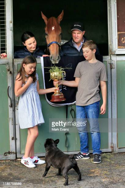 Trainer Danny O'Brien with wife Nina and kids Grace and Thomas and dog Mimi pose with Vow And Declare during the Melbourne Cup Winning media...