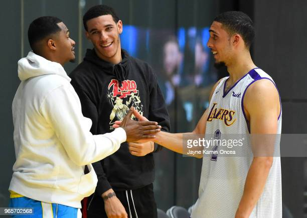 Trainer Darren Moore and Lonzo Ball of the Los Angeles Lakers greets LiAngelo Ball after he completed his NBA PreDraft Workout with the Los Angeles...