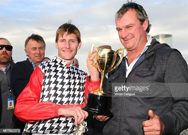Trainer Darren Weir and jockey Brad Rawiller pose with trophy after winning Race 8 the Sungold Milk Warrnambool Cup during the Warrnambool May Racing...