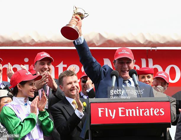 Trainer Darren Weir holds up the Melbourne Cup after his horse Prince of Penzance won The Emirates Melbourne Cup on Melbourne Cup Day at Flemington...