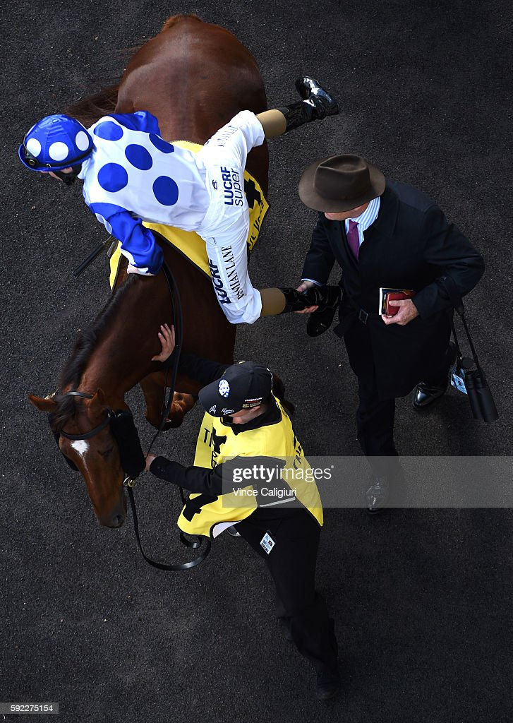 Trainer David Hayes gives Damian Lane a leg up on Catch a Fire before winning Race 3, during Melbourne Racing at Moonee Valley Racecourse on August 20, 2016 in Melbourne, Australia.
