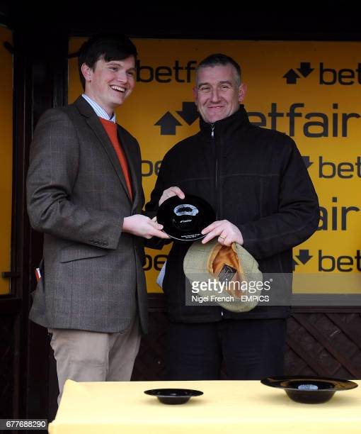 Trainer Donald McCain collects his trophy after winning the Betfair. Don't Settle For Less Novices' Chase with Our Mick
