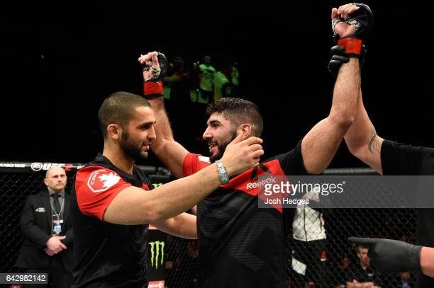 Trainer Firas Zahabi congratulates brother Aiemann Zahabi of Canada celebrates after defeating Reginaldo Vieira of Brazil in their bantamweight fight...