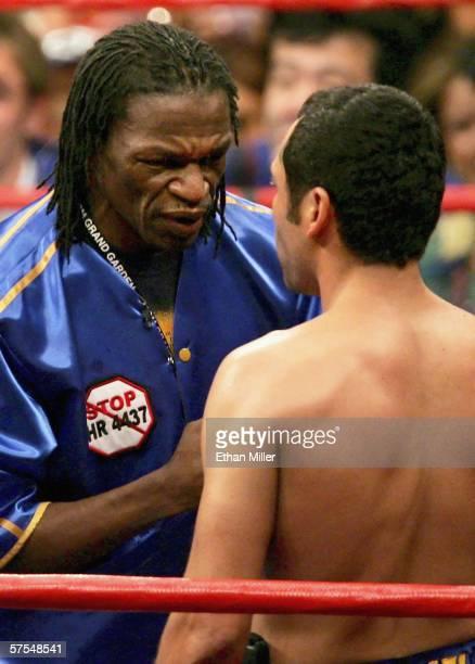 Trainer Floyd Mayweather Sr talks to Oscar De La Hoya before the WBC super welterweight title fight against Ricardo Mayorga at the MGM Grand Garden...