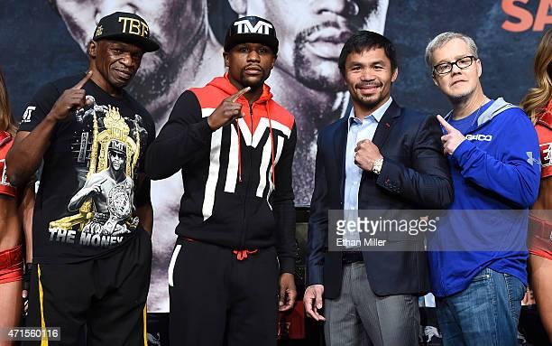 Trainer Floyd Mayweather Sr WBC/WBA welterweight champion Floyd Mayweather Jr WBO welterweight champion Manny Pacquiao and trainer Freddie Roach pose...
