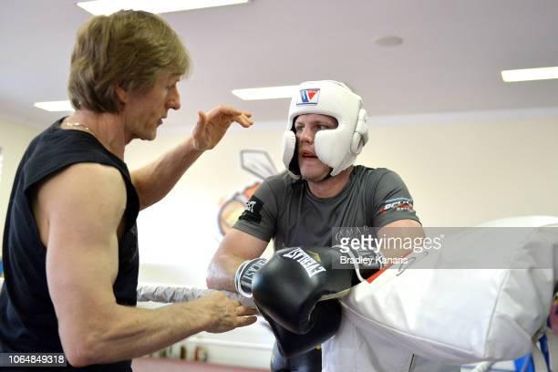 Trainer Glenn Rushton talks tactics with Jeff Horn at a training session on November 08 2018 in Brisbane Australia