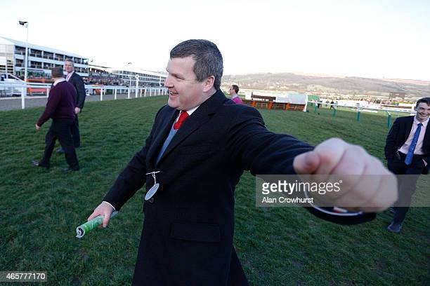 Trainer Gordon Elliott celebrates Cause Of Causes winning The Toby Balding National Hunt Steeple Chase at Cheltenham racecourse on March 10 2015 in...