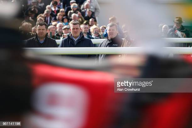 Trainer Gordon Elliott keeps an eye on the action at Punchestown racecourse on April 24 2018 in Naas Ireland