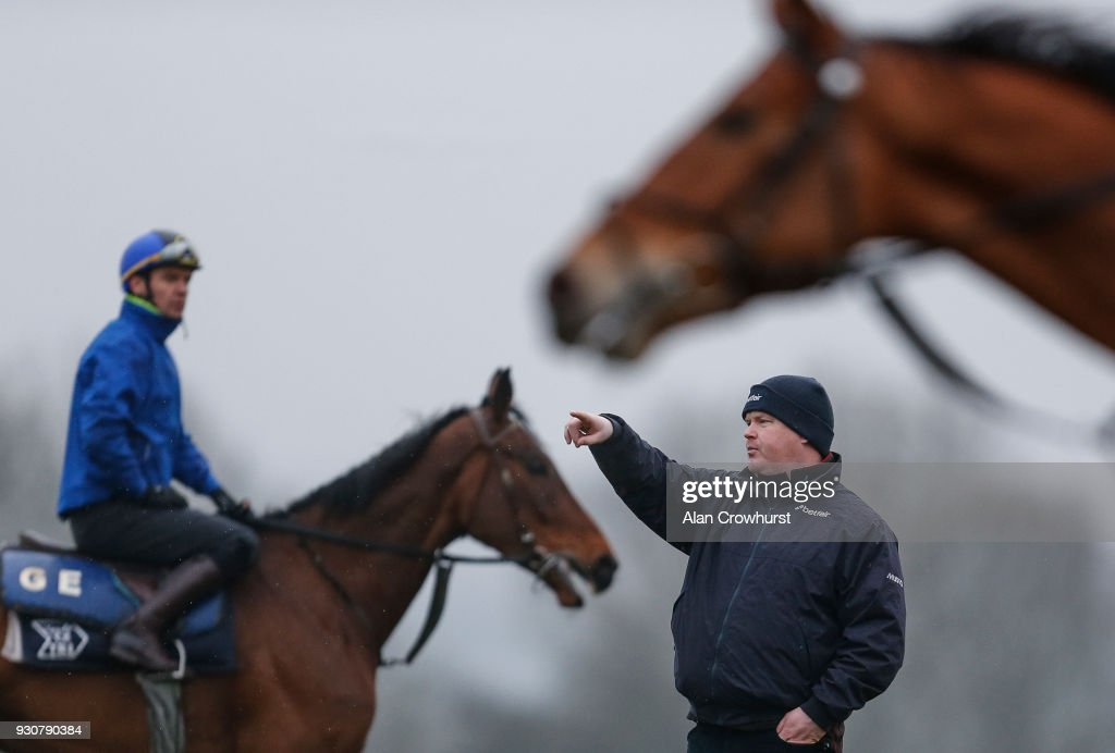 Trainer Gordon Elliott watches his string on the gallops at Cheltenham racecourse on March 12, 2018 in Cheltenham, England.