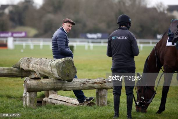 Trainer Henry de Bromhead talks with jockey Rachael Blackmore on the gallops ahead of Day Two of the Cheltenham Festival at Cheltenham Racecourse, in...