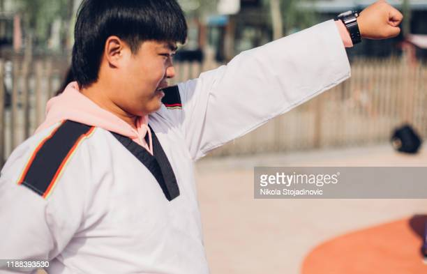 a trainer in a kimono - boxing belt stock pictures, royalty-free photos & images