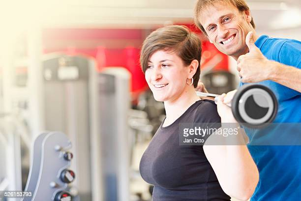trainer is happy with workout of his client - large breasts stock pictures, royalty-free photos & images