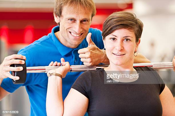 trainer is happy with workout of his client - women with large breast stock pictures, royalty-free photos & images