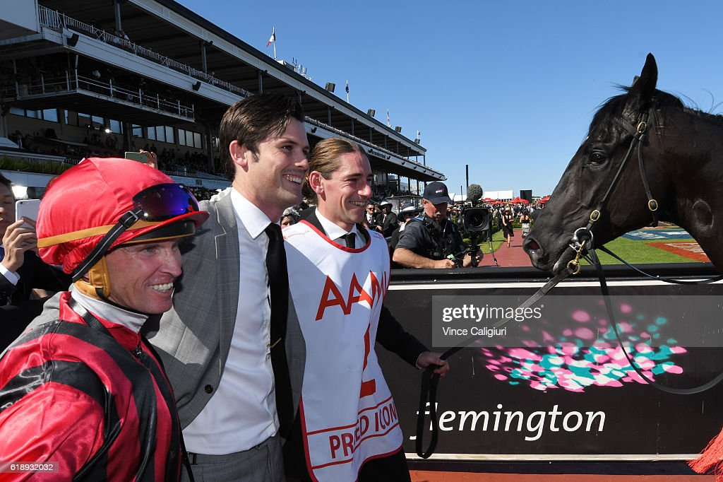 Trainer James Cummings and Glyn Schofield and strapper after Prized Icon won Race 7, AAMi Victoria Derby on Derby Day at Flemington Racecourse on October 29, 2016 in Melbourne, Australia.
