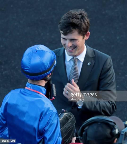 Trainer James Cummings talks to jockey Tye Angland after winning race 9 with Osborne Bulls during Sydney Racing at Royal Randwick Racecourse on March...