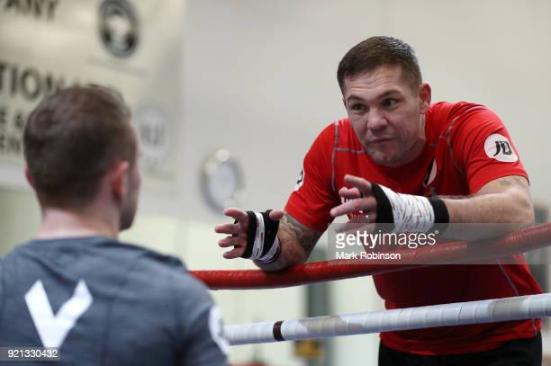 Trainer Jamie Moore speaks with Carl Frampton during a media work out session at VIP Boxing Gym on February 20 2018 in Manchester England