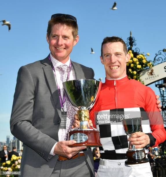 Trainer Jarrod McLean poses with John Allen after Trap For Fools won Race 8 Seppelt Mackinnon Stakes during Stakes Day at Flemington Racecourse on...