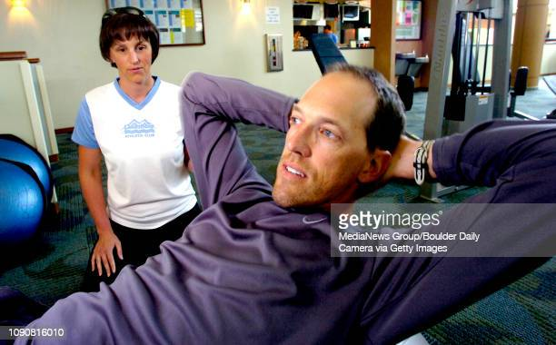 Trainer Jennifer LeseaAmes works with client Tim Wolters while working out at Lakeshore Athletic Club in Broomfield Colorado June 13 2007 LeseaAmes...