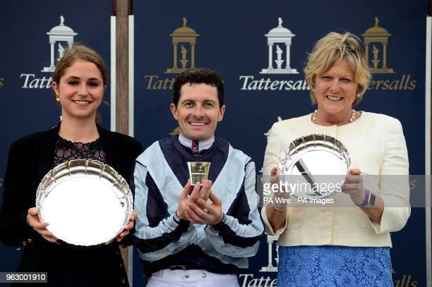 Trainer Jessica Harrington jockey Colm O'Donoghue and owner Electra Niarchos pose with their trophies after Alpha Centauri won the Tattersalls 1000...