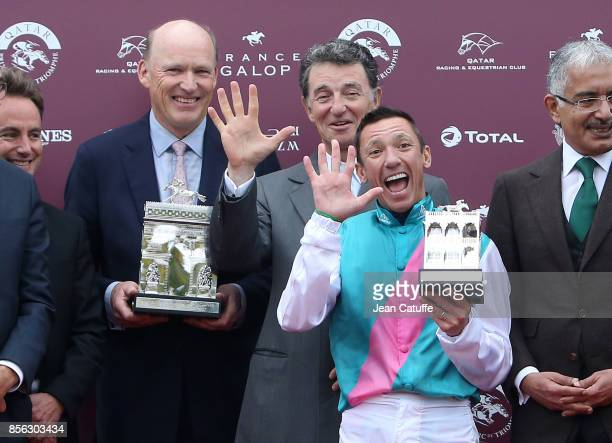 Trainer John Gosden Edouard de Rotschild jockey Frankie Dettori of Italy during the podium ceremony of Qatar Prix de l'Arc de Triomphe 2017 at...