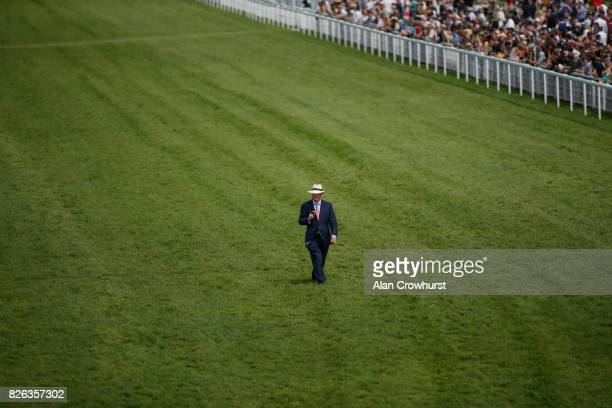 Trainer John Gosden walks the course on day four of the Qatar Goodwood Festival at Goodwood racecourse on August 4 2017 in Chichester England