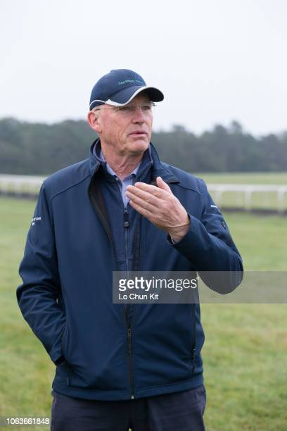 Trainer John Gosden watches Enable works during an early morning exercise gallop at Newmarket Gallops on October 5 2018 in Newmarket England