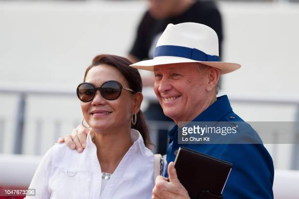Trainer John Moore and his wife celebrate after Beauty Generation winning Race 8 The Celebration Cup at Sha Tin racecourse on October 1 2018 in Hong...