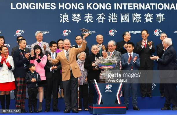 Trainer John Moore poses with trophy after Beauty Generation won Race 7 Longines Hong Kong Mile during the LONGINES Hong Kong International Races at...