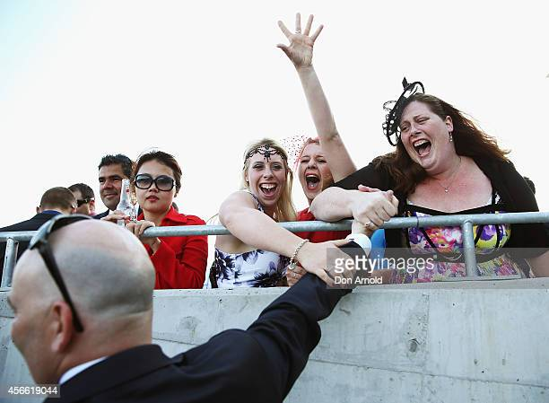 Trainer John Thompson is congratulated by Agatha Kroharska Mariel Sweeting and Rachel Asker all members of his staff upon winning the Flight Stakes...