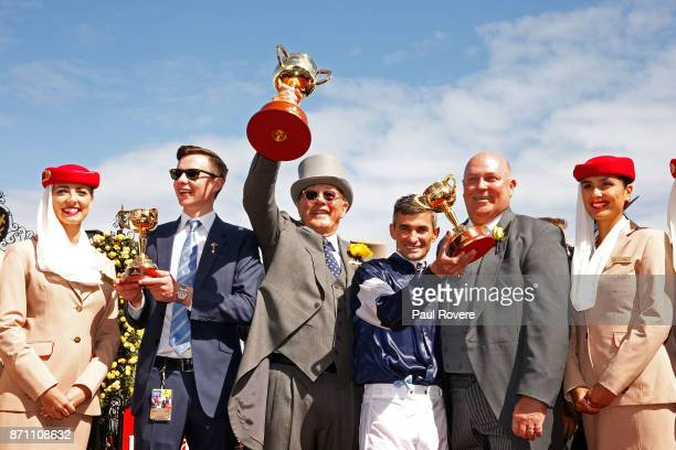 Trainer Joseph O'Brien owner Lloyd Williams jockey Corey Brown and Emirates Divisional Vice President Barry Brown celebrate after winning race 7 the...