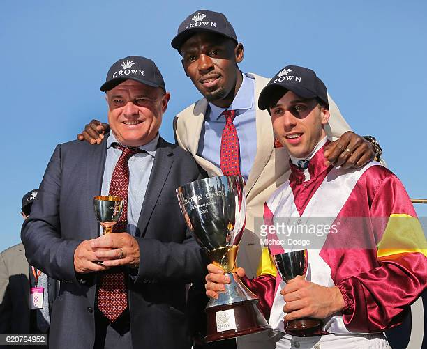 Trainer Lee Curtis and jockey Brenton Avdulla pose with Usain Bolt after winning with Lasqueti Spirit in race 8 the Crown Oaks on Oaks Day at...