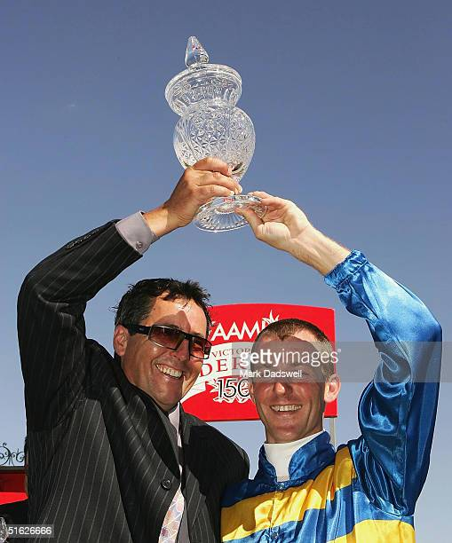 Trainer Lindsey Smith and jockey Paul Harvey celebrate after winning the AAMI Victoria Derby with Plastered during the AAMI Victoria Derby Day at...