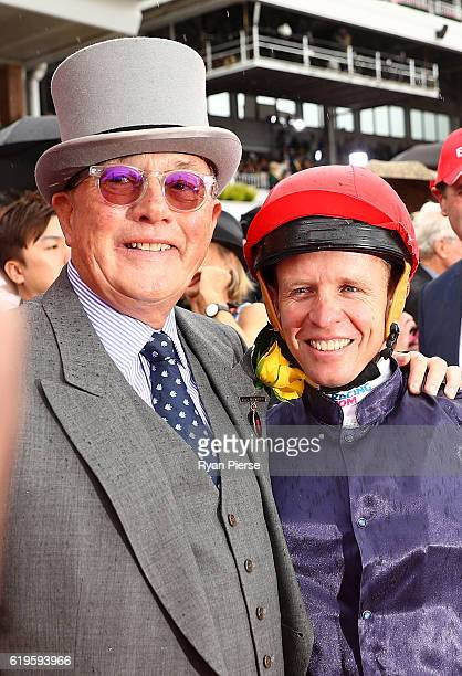 Trainer Lloyd Williams congratulates Kerrin McEvoy after he rode Almandin to win race 7 the Emirates Melbourne Cup on Melbourne Cup Day at Flemington...