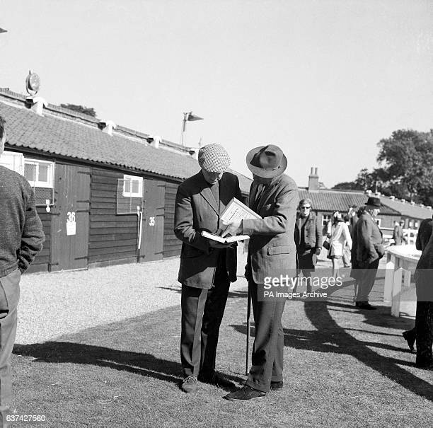Trainer Major Dick Hern and Lord Porchester examine the pedigrees of horses for sale