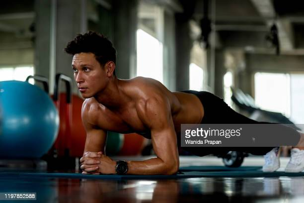 trainer man exercise for  functional plank training and gym the gym workout for healthy care and body building.  fitness instructor exercising the fitness. healthy sport concept - 自重トレーニング ストックフォトと画像