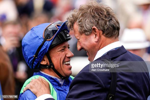 Trainer Mark Johnston with Frankie Dettori after he rides Poets Society to win giving the trainer his 4194th domestic British winner a new record at...