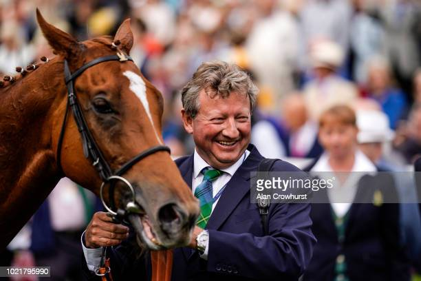Trainer Mark Johnston with Poets Society giving the trainer his 4194th domestic British winner a new record at York Racecourse on August 23 2018 in...