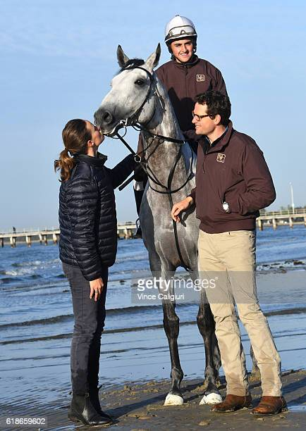 Trainer Matt Cumani and sister Francesca Cumani pose with Grey Lion with track rider Bastion Neuhaus after a trackwork session at Altona Beach ahead...