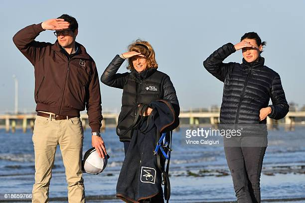 Trainer Matt Cumani is seen with sister Francesca Cumani and mother Sarah Cumani watching Grey Lion during a trackwork session at Altona Beach ahead...
