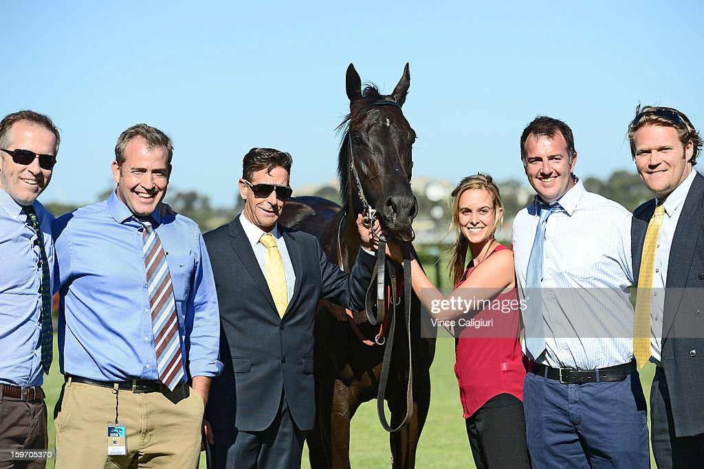 Trainer Michael Kent (3rd from L) and winning connections with Danish Whiskey after winning the Domain Handicap during Melbourne racing at Flemington Racecourse on January 19, 2013 in Melbourne, Australia.