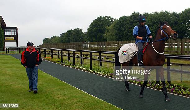 Trainer Mike De Kock chats with Juan Nell before J J The Jet Plane works on Newmarkets July Racecorse on June 11 2009 in Newmarket EnglandThe South...