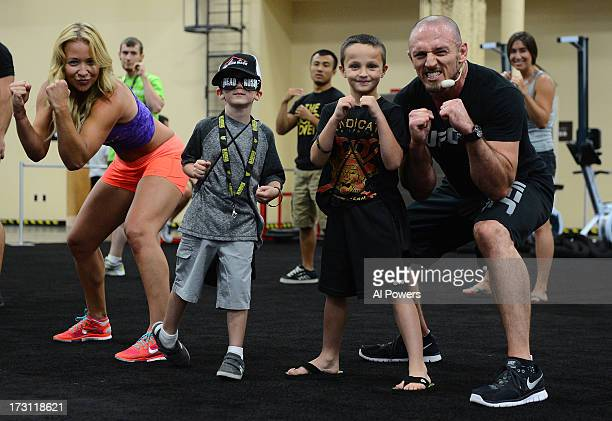 Trainer Mike Dolce poses for a photo with young fans during a UFC Fit demo at the UFC Fan Expo Las Vegas 2013 at the Mandalay Bay Convention Center...