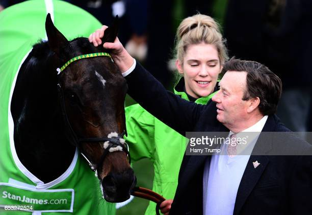 Trainer Nicky Henderson celebrates after Buveur D'Air wins the Stan James Champion Hurdle Challenge Trophy during Champion Day of the Cheltenham...