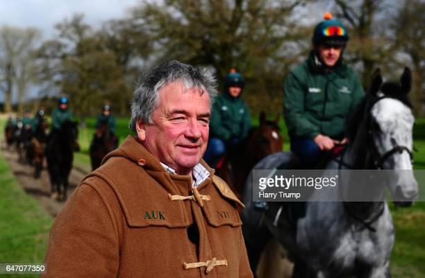 Trainer NigelTwiston Davies looks on as Bristol De Mai makes its way past during A Nigel TwistonDavies Stable Visit at Grange Hill Farm on March 2...