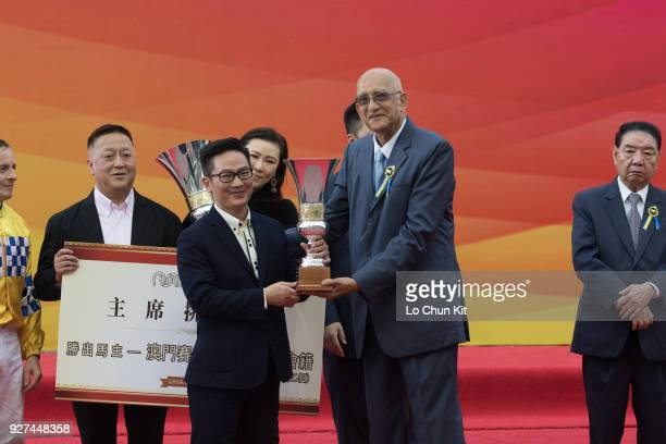 Trainer of Felizmaster K S Wong receives the trophy after winning Race 6 Chairman's Challenge Cup during Macau Hong Kong Trophy Day at Taipa...